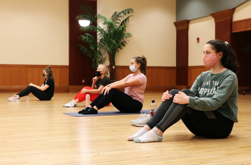 <p>(Left to right) Lily Staatz, Megan Thomas, Choe Freeman and Colleen Dyra sit before a workout for Ball State's chapter of CHAARG March 18, 2021, in the L.A. Pittenger Student Center. Due to COVID-19 limitations, the organization only meets once a month for in-person workouts. <strong>Rylan Capper, DN</strong></p>
