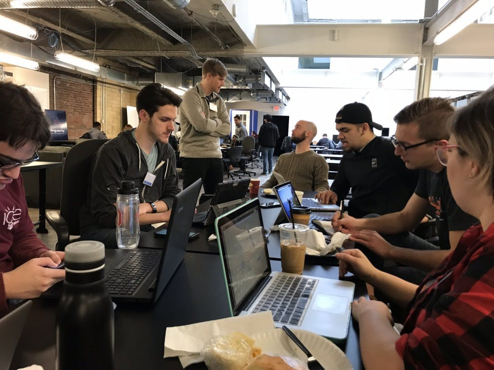 Ball State students Alex Kane and Guadalupe Vega working with their team at the Startup Weekend February in Columbus, Ohio. Startup Weekend is taking place Oct. 5 to 7 in the Applied Technology Building for the first time on Ball State's campus. Karen Lloyd, Photo Provided