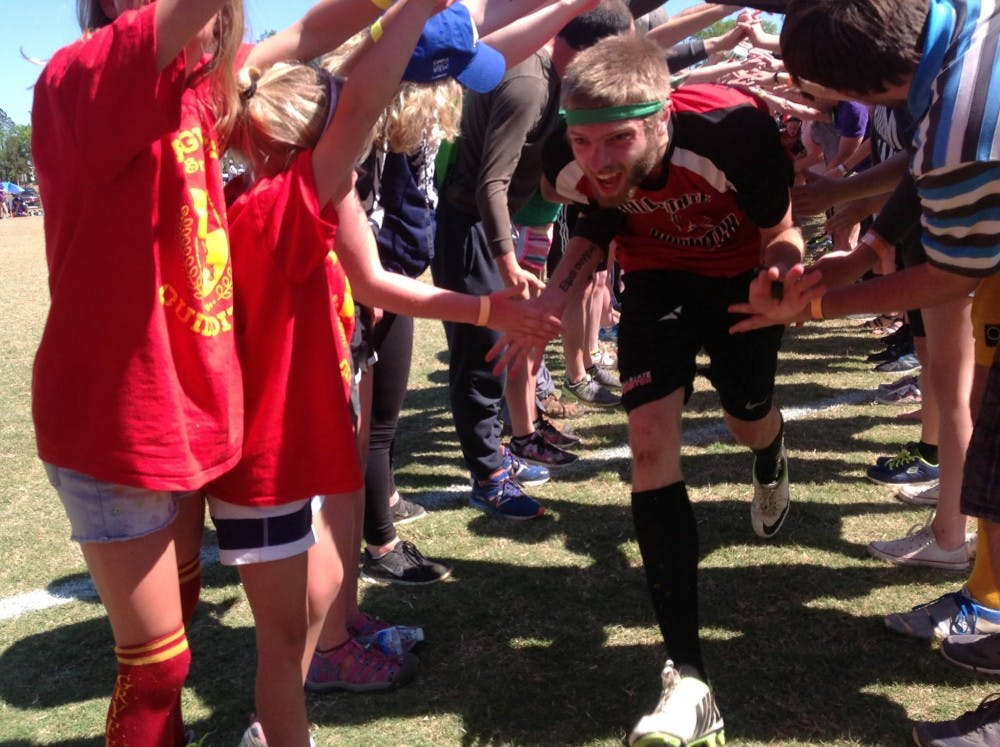 """<p>Shown above, Blake Fitzgerald runs through a tunnel of people after Ball State beat Texas, the defending champions, to advance on to the final four. Fitzgerald continued to play three more game after he broke his nose in an earlier game.&nbsp;<i style=""""background-color: initial;"""">PHOTO PROVIDED BY KIM BELCHER</i></p>"""