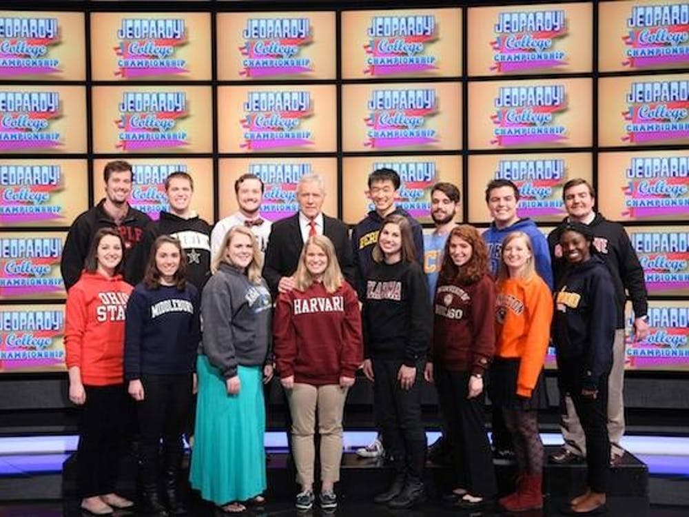 Senior marketing major Alex Sventeckis poses with 14 other contestants and Alex Trebek on the set of the