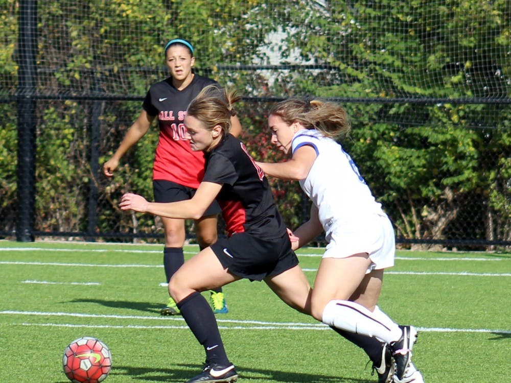 A Ball State soccer player attempts to keep the all away from her opponent in the match against Buffalo on Oct. 25 at the Briner Sports Complex. DN PHOTO ALLYE CLAYTON