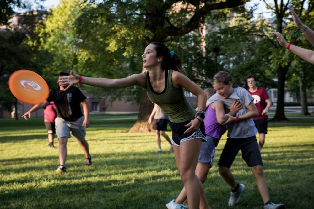 <p>Locals play a game of pick-up ultimate Frisbee in the quad at Ball State University Aug, 23, 2019. Quad Bash is a community event for students and locals to hang out and make friends after the first week of classes at Ball State. <strong>Eric Pritchett, DN</strong></p>