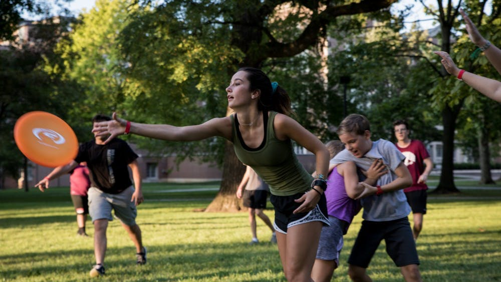 Locals play a game of pick-up ultimate Frisbee in the quad at Ball State University Aug, 23, 2019. Quad Bash is a community event for students and locals to hang out and make friends after the first week of classes at Ball State. Eric Pritchett, DN