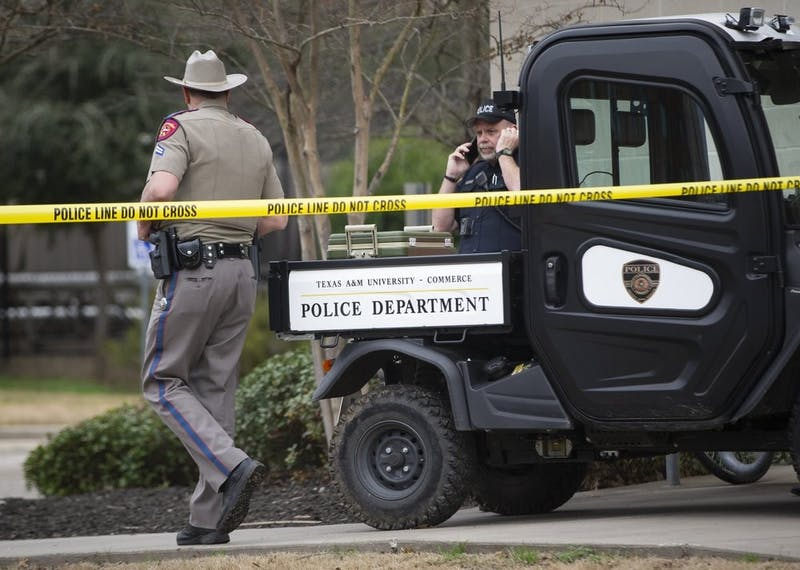 Law enforcement officers work the scene a shooting outside of the Pride Rock residence at Texas A&M University-Commerce in Commerce, Texas, Monday, Feb. 3, 2020. (Juan Figueroa/The Dallas Morning News via AP)