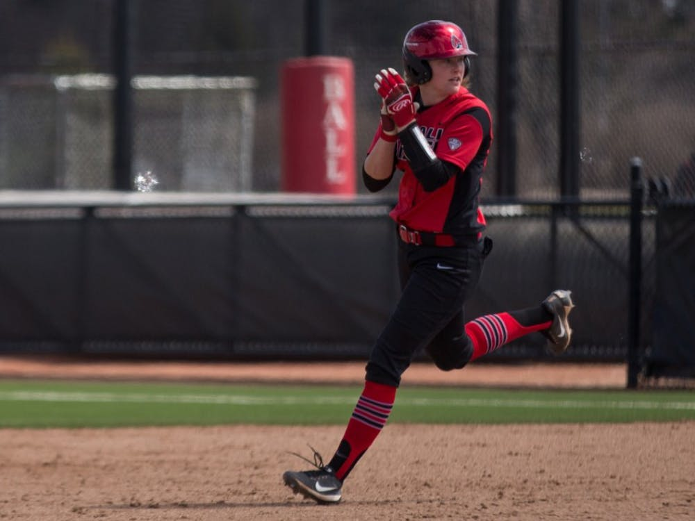 Junior Olivia Huffman cheers on her way to second base as one of her teammates scores in the second inning during the Cardinals' game against Kent State April 7 at the Softball Field at First Merchants Ballpark Complex. Eric Pritchett, DN
