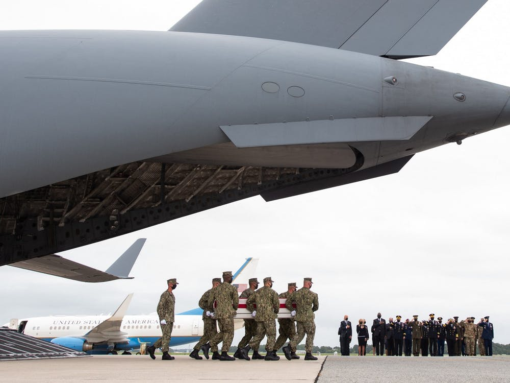 U.S. President Joe Biden and other officials attend the dignified transfer of the remains of fallen service members at the Dover Air Force Base in Dover, Delaware, Aug. 29, 2021, after 13 members of the U.S. military were killed in Afghanistan last week. U.S. troops officially left Afghanistan Aug. 30, ending their participation in a 20-year-long war. Saul Loeb/AFP via Getty Images/TNS, Photo Courtesy