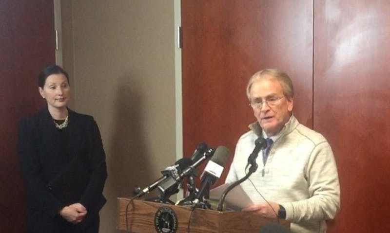 (From left) City Attorney Megan Quirk and Muncie Mayor Dennis Tyler held a press conference today in response to the arrest of Muncie's building commissioner on Wednesday. Craig Nichols, 38, was charged with 16 counts of wire fraud, one count of theft of government funds and 16 counts of money laundering, according to the indictment. Max Lewis // DN