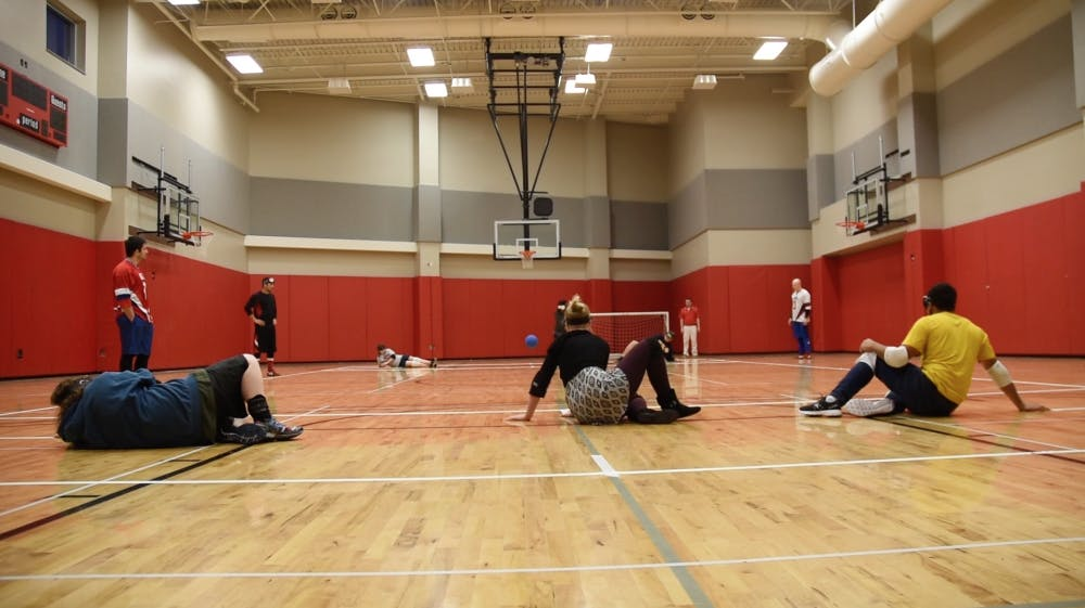 <p>Ball State students try out goalball after olympic athletes teach them how to play on March 22.&nbsp;&nbsp;DN PHOTO PATRICK CALVERT</p>
