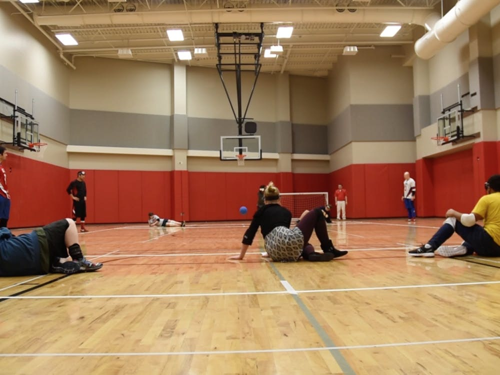 Ball State students try out goalball after olympic athletes teach them how to play on March 22.DN PHOTO PATRICK CALVERT