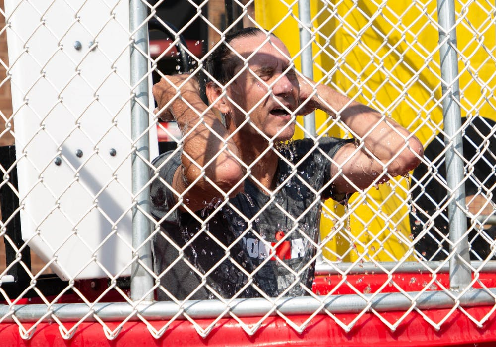 <p>Muncie Mayor Dan Ridenour wipes water out of his eyes after falling into a dunk tank to raise money for charity in the Village, Aug. 28. Ridenour chose to raise money for local charities Heart of Indiana United Way and Home Savers of Delaware County. <strong>Adele Reich, DN</strong></p>