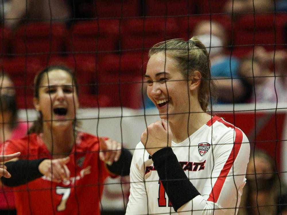 Sophomore middle blocker Lauren Gilliland (11) celebrated three successful blocks in a row against Ohio at Worthen Arena Oct. 1. Ball State will take on Akron Oct. 8. Jacy Bradley, DN