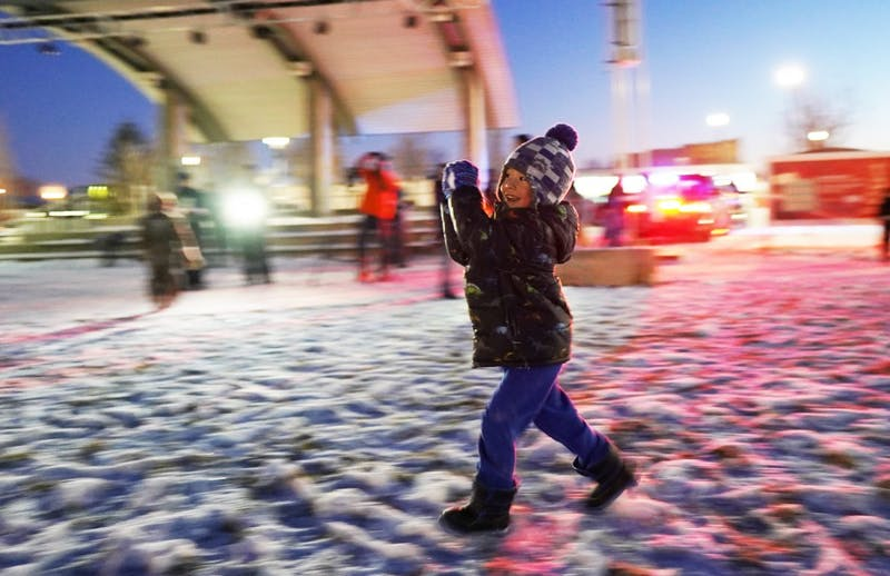 Lucas Feeney, 4, runs with a snowball during an event hosted by the Muncie Police Department (MPD) Jan. 27, 2019, at Canon Commons. The Muncie community received the chilly challenge at 6:30 that night. Scott Fleener, DN