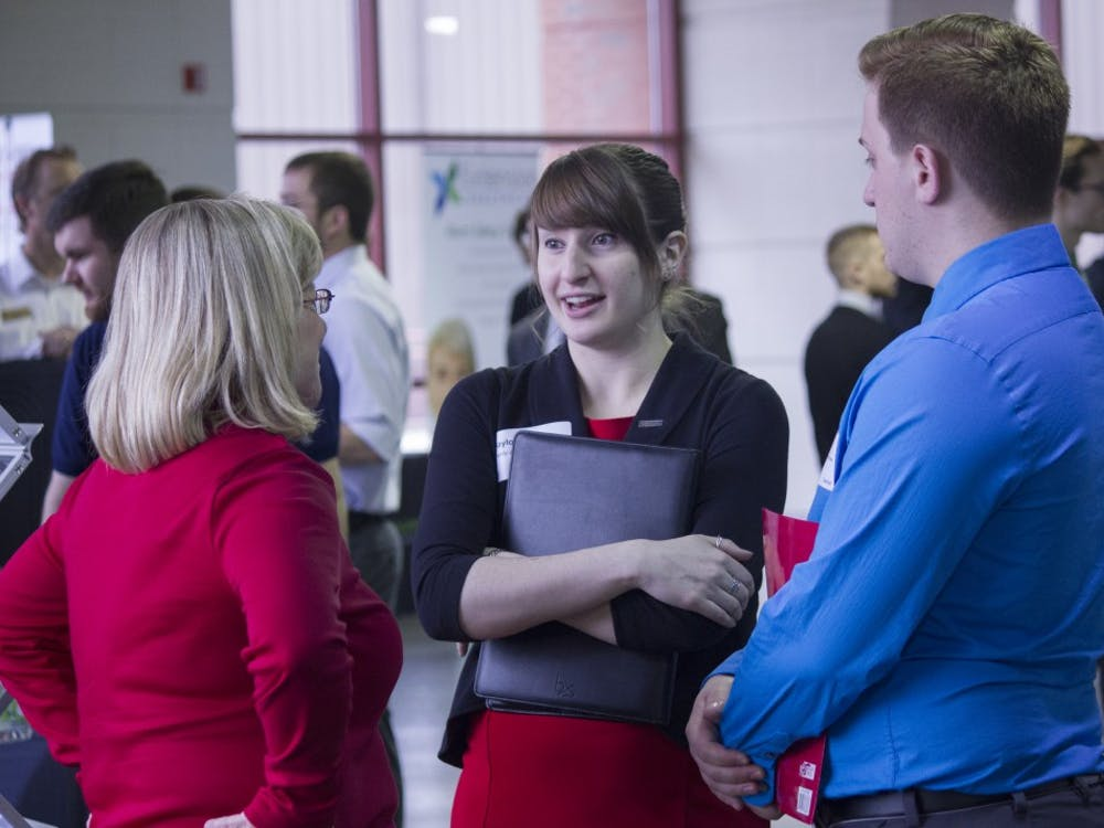Students talk to a business representative during the Cardinal Job Fair on Feb. 11 at Worthen Arena. DN PHOTO JESSICA LYLE