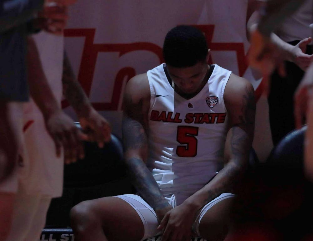 <p>Junior guard Ishmael El-Amin bows his head and waits before his name is called Feb. 25, 2020, at John E. Worthen Arena. <strong>Jacob Musselman, DN</strong></p>