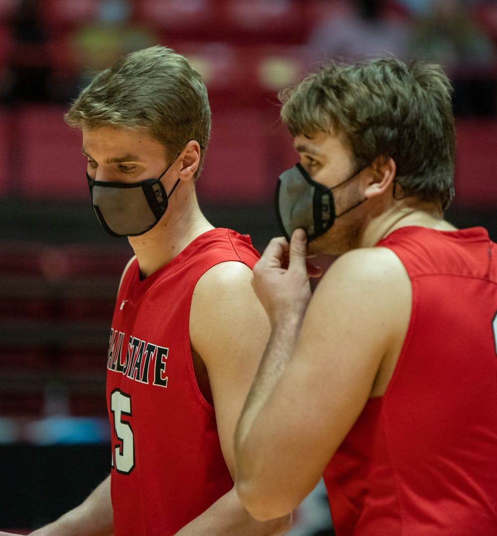 <p>Senior middle attacker Will Hippe talks to graduate student Blake Reardon after a play Jan. 29, 2021, in John E. Worthen Arena. Hippe had 9.5 points against Lincoln Memorial University. <strong>Jaden Whiteman, DN</strong></p>