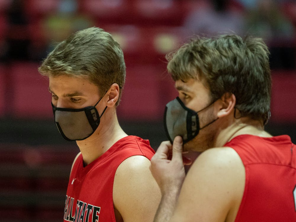 Senior middle attacker Will Hippe talks to graduate student Blake Reardon after a play Jan. 29, 2021, in John E. Worthen Arena. Hippe had 9.5 points against Lincoln Memorial University. Jaden Whiteman, DN