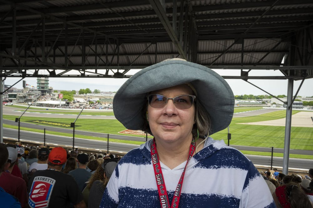 <p>Jacquelyn Buckrop stands at her seats for the Indianapolis 500 May 26, 2019, at Indianapolis Motor Speedway. With the exception of 2020, Buckrop has only missed one Indy 500 since 1974.<strong>Stephanie Amador, DN</strong></p>