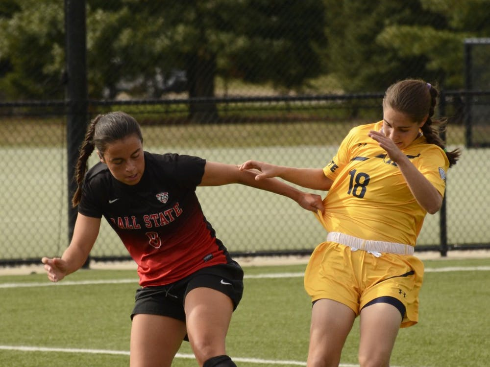 Ball State junior midfielder Paula Guerrero fights for the ball with Kent states freshman midfielder Vital Kats on Oct. 1 at Briner Sports Complex. The Cardinals won 1-0. Harrison Raft, DN