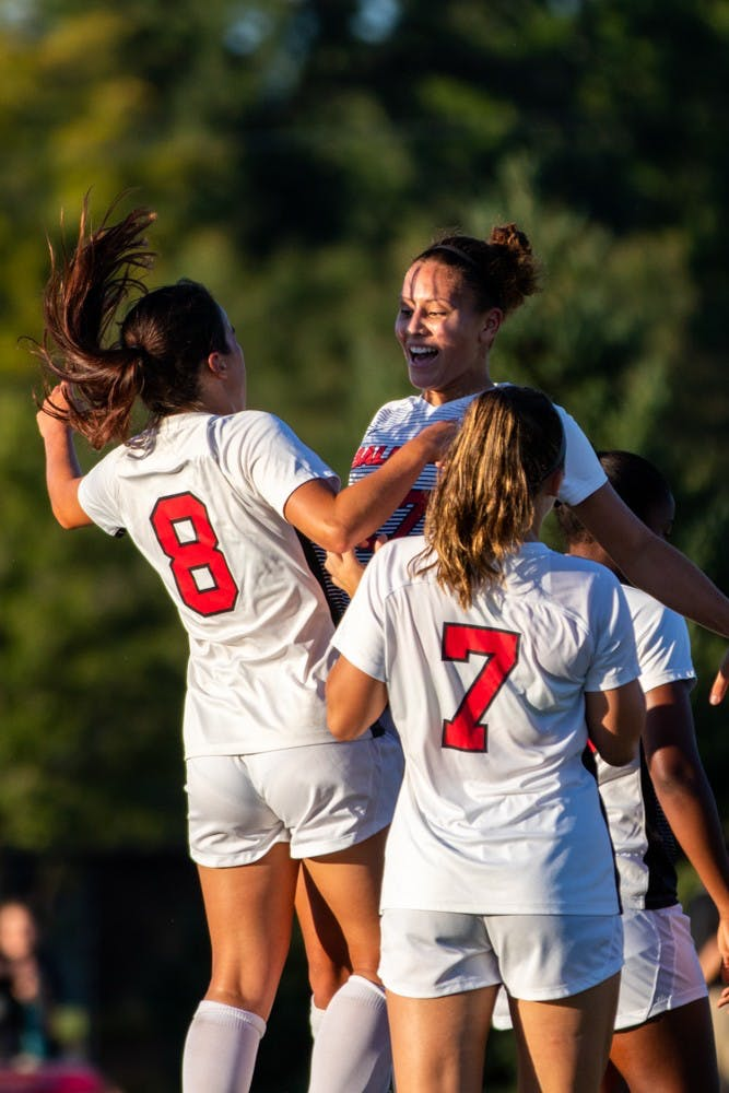 Paula Guerrero and Julia Elvbo chest bump to celebrate Guerrero scoring Ball State's third goal of the game securing the Cardinals' victory against the University of Nebraska-Omaha Friday, Sept. 14, 2018 at Briner Sports Complex . All points were scored in the second half of the game where Ball State won 3 to 1. Eric Pritchett,DN