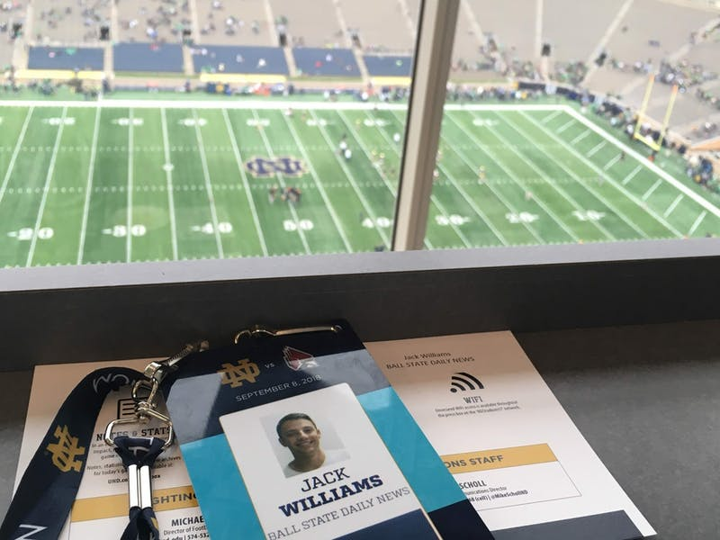 "William's press pass sits on his desk Sept. 8, 2018, at Notre Dame Stadium in South Bend, Indiana. ""While Scheumann Stadium and Worthen Arena were comfy,"" Williams said, ""I always took advantage of reporting from a bigger stadium."" Jack Williams, photo provided"