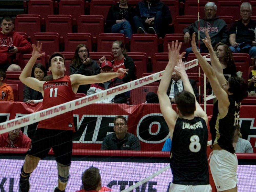 Senior Mitch Weiler spikes the ball over the net during the game against Lindenwood University on March 30 at John E. Worthen Arena. Weiler had one ace during the game. Rebecca Slezak, DN