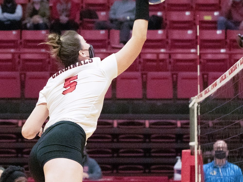 Sophomore middle blocker Marie Plitt spikes the ball Feb. 12, 2021, in John E. Worthen Arena. The Cardinals lost to the Falcons 0-3. Madelyn Guinn, DN