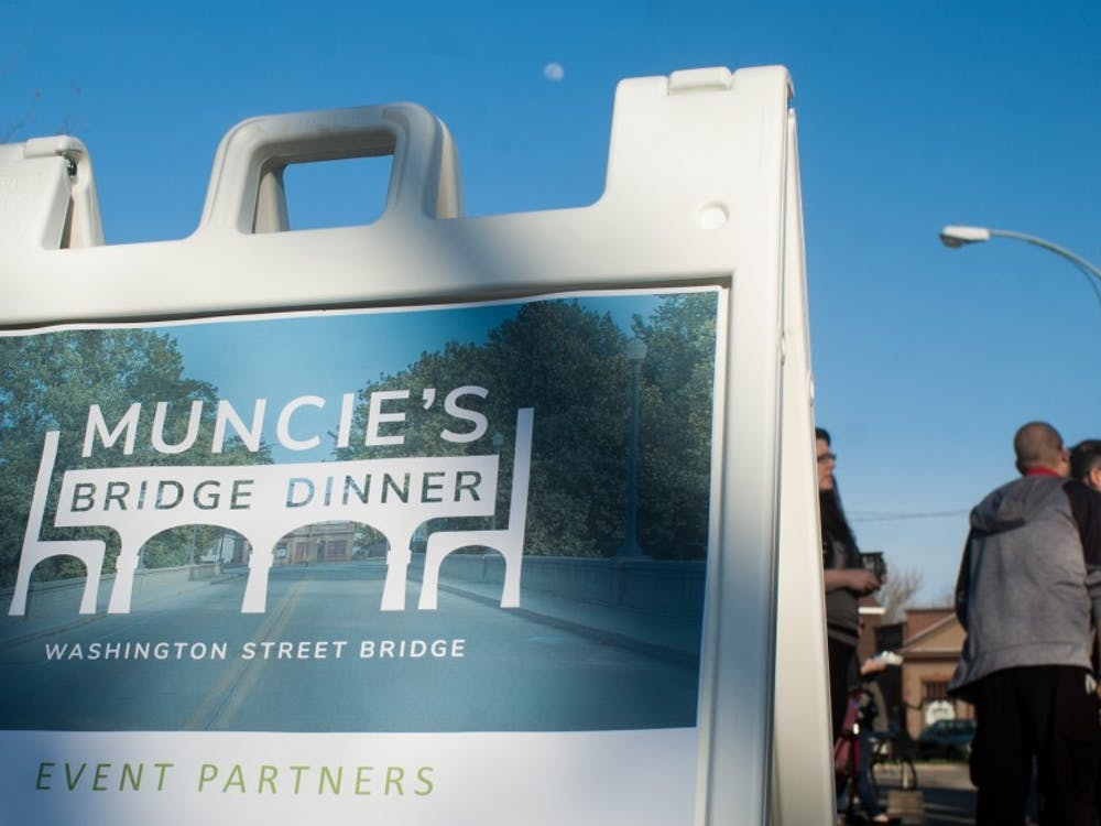 Community members gathered on the Washington Street Bridge April 26 for the annual Muncie's Bridge Dinner for food, drinks, art and live music. This was the second Muncie's Bridge Dinner.