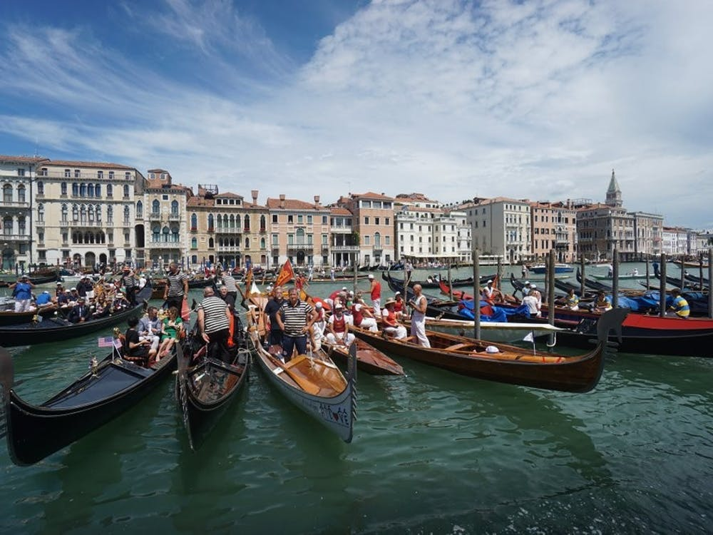 Gondolas are lined up during the Vogada della Rinascita regatta, June 21, 2020, along Venice canals, Italy. European Union envoys are close to finalizing a list of countries whose citizens will be allowed back into Europe once it begins lifting coronavirus-linked restrictions. (Anteo Marinoni/LaPresse via AP, File)