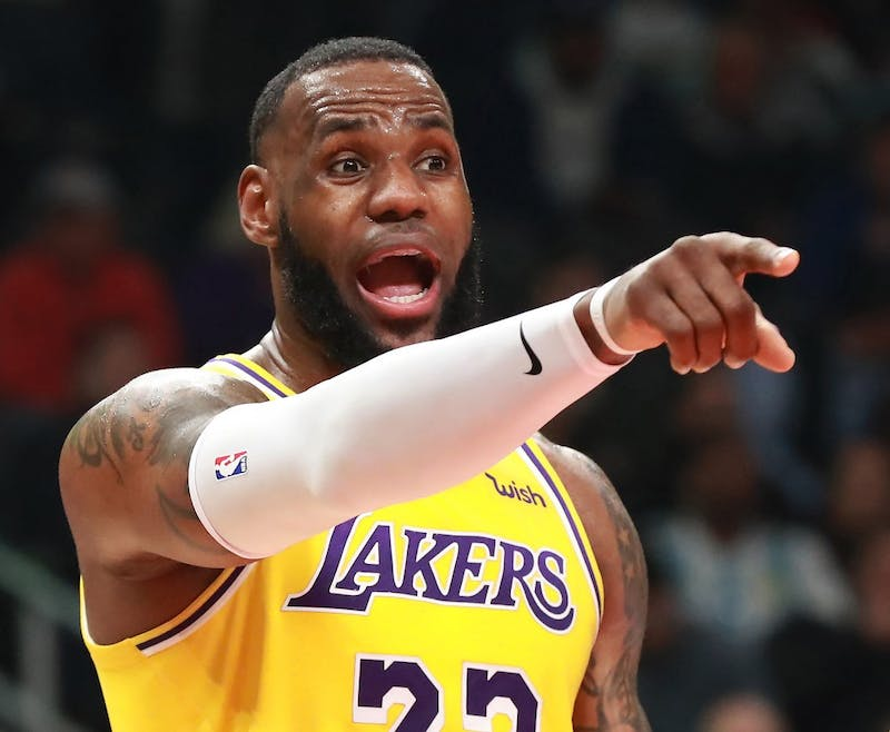 The Los Angeles Lakers' LeBron James directs his team against the Atlanta Hawks on Feb. 12, 2019, at Philips Arena in Atlanta. (Curtis Compton/Atlanta Journal-Constitution/TNS)