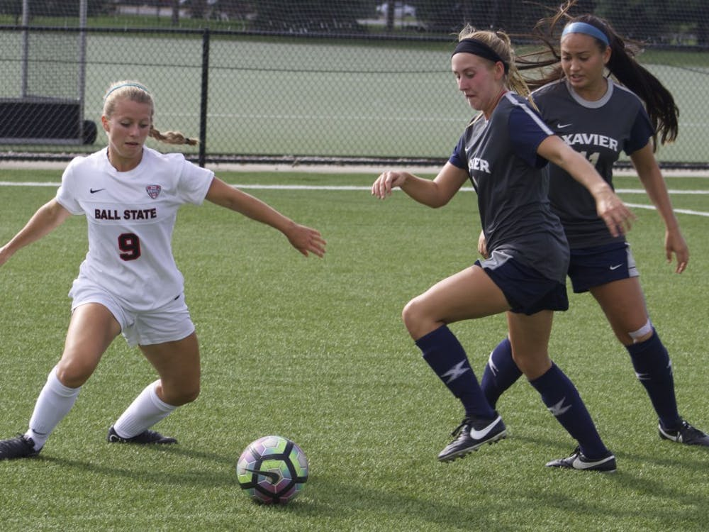 Junior midfielder/forward Allison Abbe fights for the ball during women's soccer's Aug. 25 match against Xavier University. Ball State tied 1-1 after a double overtime. Kara Berg // DN