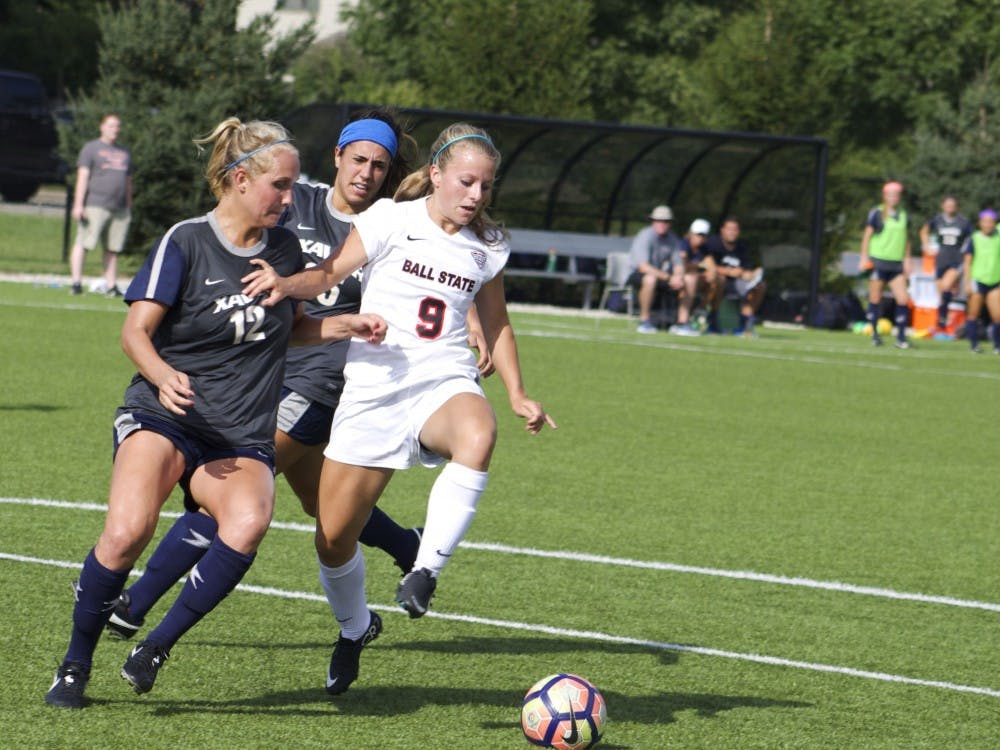 Junior midfielder/forward Allison Abbe fends off attackers from the rival team, Xavier University, during their match Aug. 25. Ball State tied 1-1 after a double overtime. Kara Berg // DN