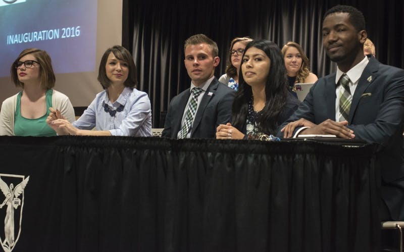 Bailey Loughlin, president pro-tempore; Emily Halley, treasurer; Brock Frazer, secretary; Ana Batres, vice president; and James Wells, president, all sit in the front of the Cardnial Hall C at the L.A. Pittenger Student Center on April 20. DN PHOTO STEPHANIE AMADOR