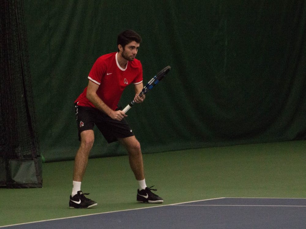 Junior Ball State tennis player Tom Carney plays against Eastern Illinois players Jared Woodson and Freddie Ammer in the match on Jan. 22 at Muncie's Northwest YMCA. The Cardinals won 6-1. Grace Ramey, DN File