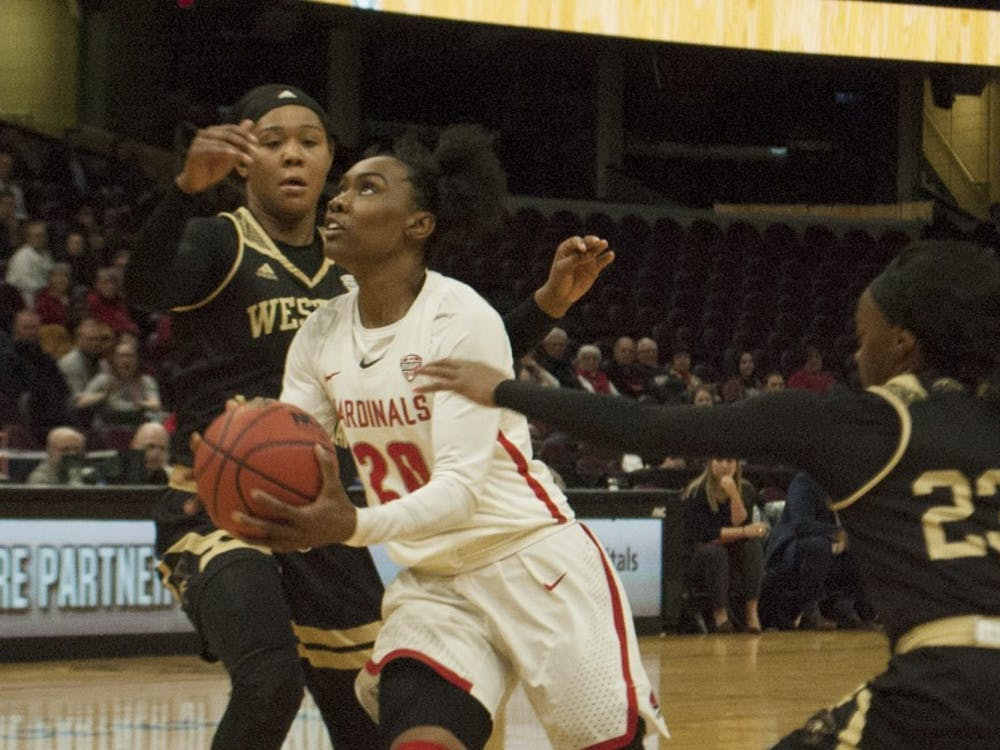 Ball State senior guard Frannie Frazier dribbles through a pair of Western Michigan defenders during the quarterfinal round of the Mid-American Conference Tournament. Robby General, DN