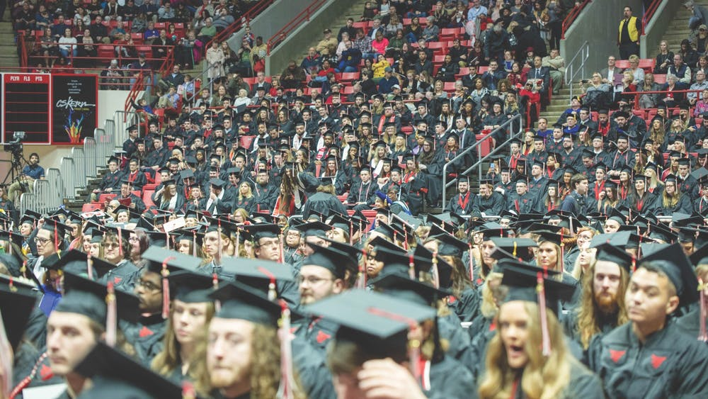 Fall 2019 Ball State graduates get ready to turn the tassels on their caps Dec. 14, 2019, at John E. Worthen Arena. Ball State's spring 2020 graduation ceremony was postponed due to COVID-19 concerns, and those graduates were invited to attend commencement this semester. Jacob Musselman, DN