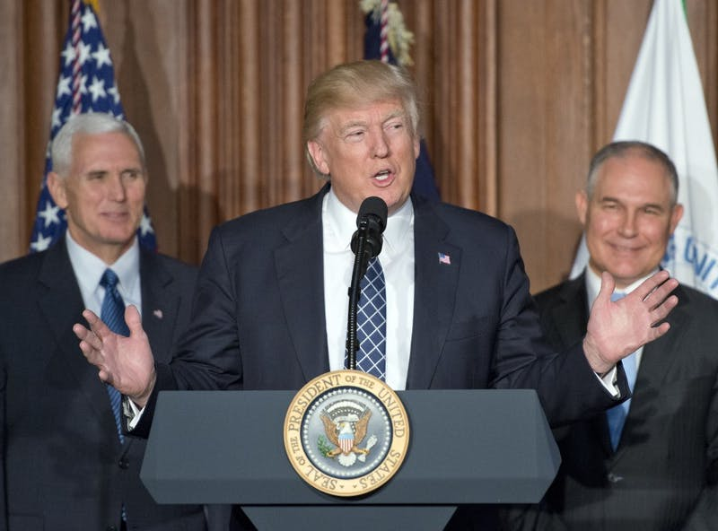 President Donald Trump makes remarks prior to signing an Energy Independence Executive Order at the Environmental Protection Agency headquarters in Washington, D.C., on Thursday, March 28, 2017. Vice President Mike Pence, left, and EPA Administrator Scott Pruitt, right, look on. (Ron Sachs/CNP/Pool/Sipa USA/TNS)