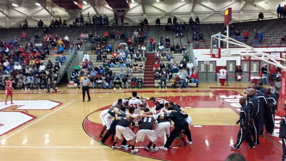 Richmond boy's basketball team huddles before a IHSAA Regional Semi-Final game against Brownsburg at Southport High School March 14, 2015. Clemens and the Red Devils defeated Brownsburg, 71-65, to advance to state semifinals.  Daric Clemens, photo provided