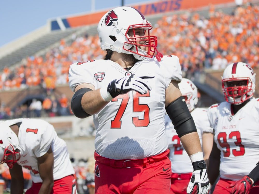 Ball State offensive lineman Vinnie Palazeti leads the team's captains onto the field before their match against the University of Illinois on Sept. 2, 2017. Ball State hosts UAB Saturday for their first home game. Robby General, DN