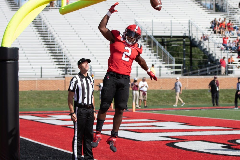 <p>Junior running back Caleb Huntley dunks the ball on the goal post after scoring a touchdown against Fordham Sept. 7, 2019, at Scheumann Stadium. Huntley averaged 4.9 yards per carry during the game. <strong>Jacob Musselman, DN</strong></p>