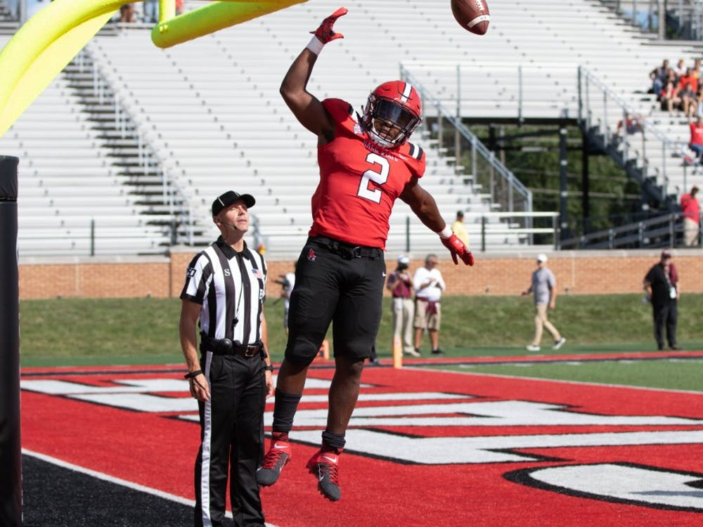 Junior running back Caleb Huntley dunks the ball on the goal post after scoring a touchdown against Fordham Sept. 7, 2019, at Scheumann Stadium. Huntley averaged 4.9 yards per carry during the game. Jacob Musselman, DN
