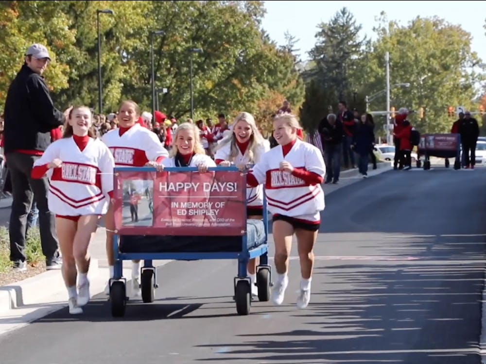The Ball State Cheerleaders push their bed across the finish during the annual Ball State Bed Race in 2019