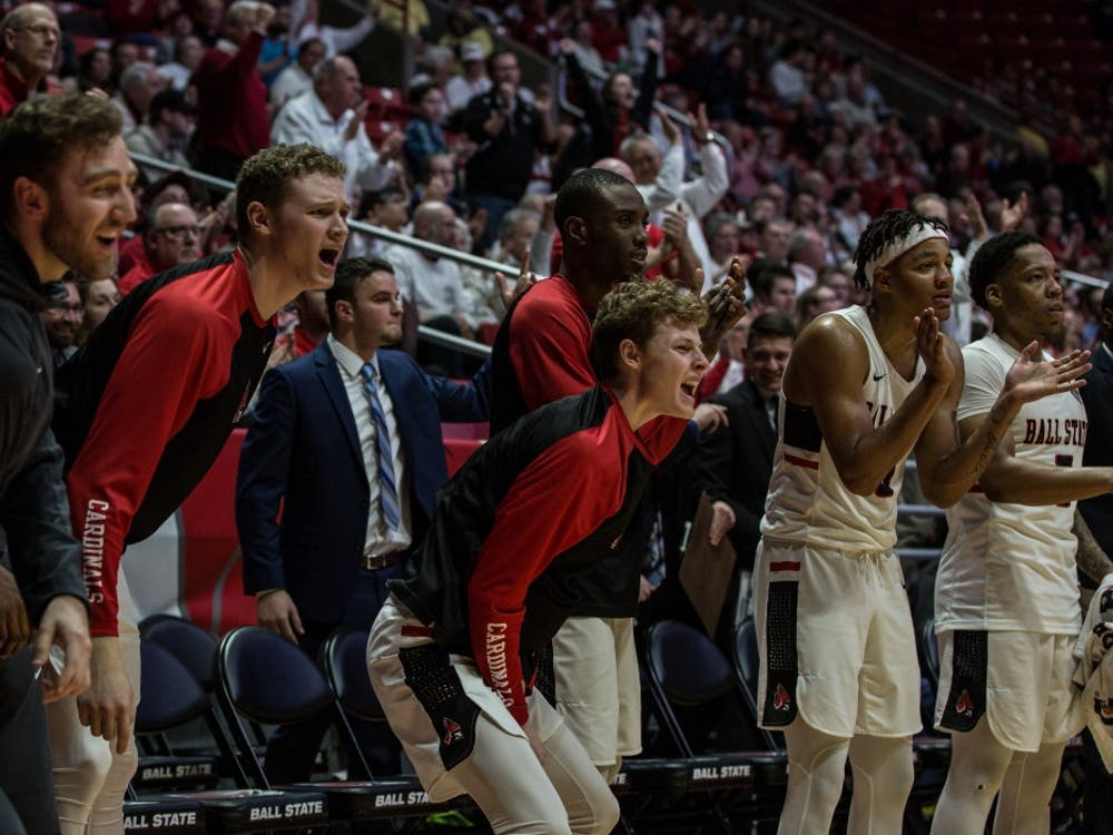 The Cardinals cheer for their team at the home game in John E. Worthen Arena Feb. 23 against the Broncos. Ball State lost 80-87. Rebecca Slezak, DN