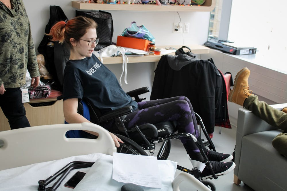 <p>Jessica Vanhook shows off her new skills in a wheelchair after her family arrived for a visit at Shirley Ryan Ability Lab in Chicago, Nov. 2, 2019. Vanhook is currently going through physical therapy and learning to adapt to a new lifestyle.<strong> Josh Smith, DN</strong></p>