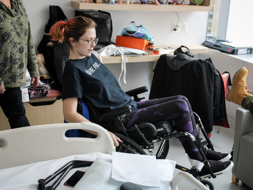 Jessica Vanhook shows off her new skills in a wheelchair after her family arrived for a visit at Shirley Ryan Ability Lab in Chicago, Nov. 2, 2019. Vanhook is currently going through physical therapy and learning to adapt to a new lifestyle. Josh Smith, DN