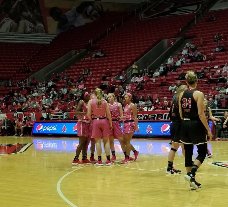 Ball State Women's basketball huddles up before a free throw attempt in a game against Northern Illinois on Feb. 9 at Worthen Arena. The Cardinals fell to the Huskies, 93-83. Daric Clemens, DN