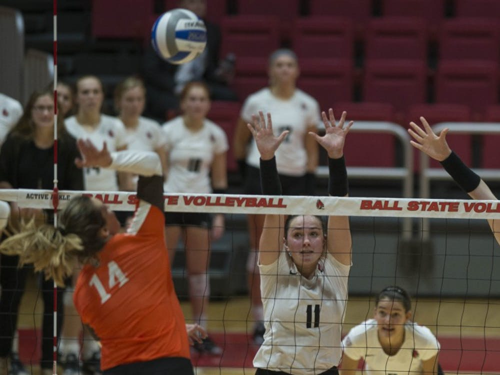 Sophomore setter Amber Seaman and junior middle hitter Emily Holland attempt to block a shot from a Bowling Green player on Oct. 20 at Worthen Arena. Breanna Daugherty, DN File