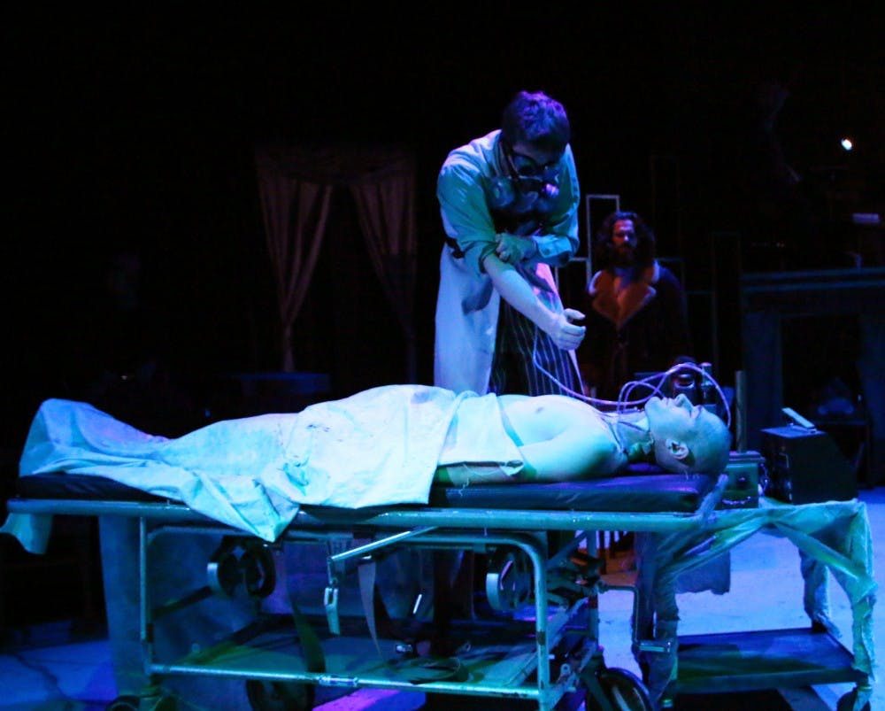 Frankenstein, played by Cole Abell, works on The Creature, played by Nick Murhling, during the final dress rehearsal of