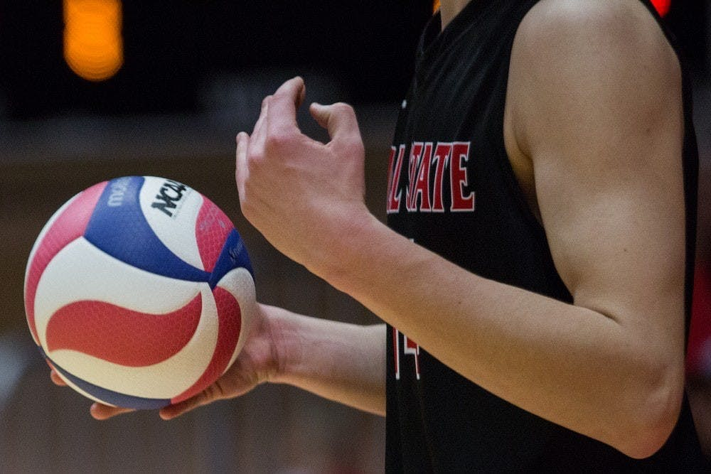 Sophomore Matt Szews gets ready to serve to Ohio State in the fifth set during the Cardinals' game against the Buckeyes on senior night in John E. Worthen Arena April 7. Eric Pritchett, DN