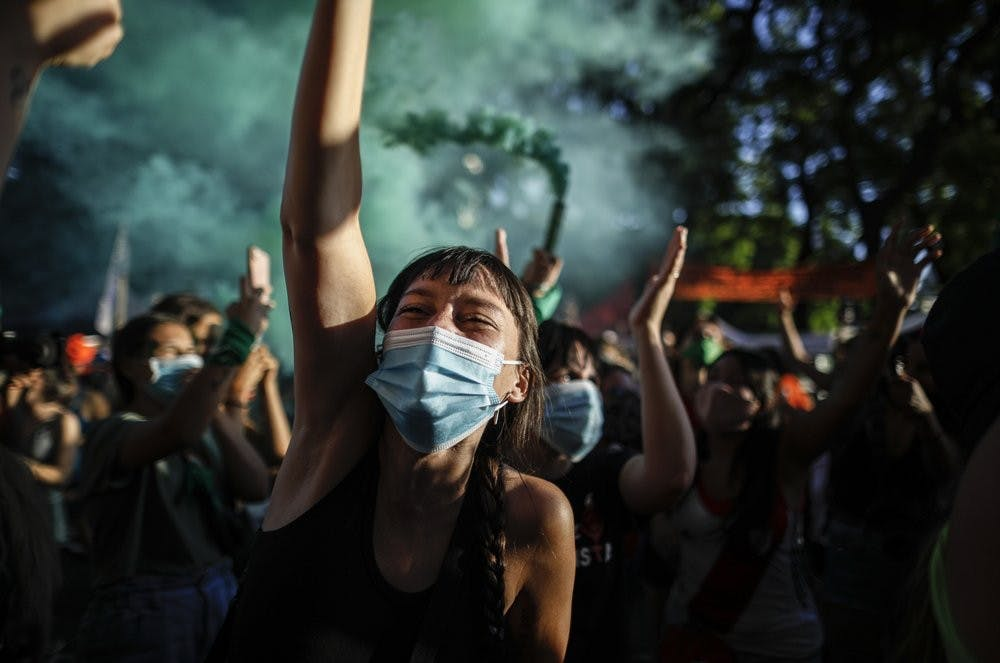 Abortion-rights activists participate in a demonstration for the decriminalization of abortion, outside Congress as lawmakers debate a bill on its legalization, in Buenos Aires, Argentina, Thursday, Dec. 10, 2020. (AP Photo/Natacha Pisarenko)
