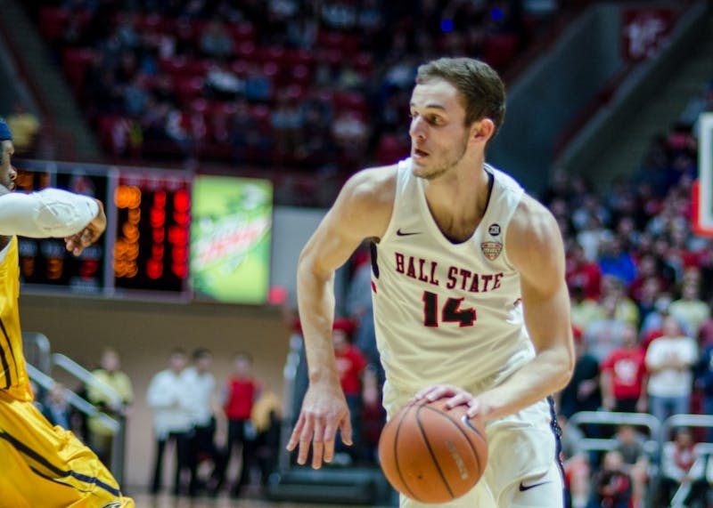 Sophomore forward Kyle Mallers runs the ball down the court passing his Kent State opponent Feb. 9 at John E. Worthen Arena. Ball State wins the game 87-68. Stephanie Amador, DN
